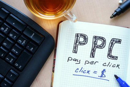 Notepad with words PPC pay per click concept and marker.